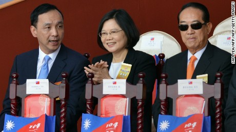 (L to R) Eric Chu, chairman of Taiwan's ruling Kuomintang (KMT), Tsai Ing-wen, chairwoman of Taiwan's main opposition Democratic Progressive Party (DPP), and James Soong, chairman of the opposition People First Party (PFP) attend a National Day ceremony in front of the presidential palace in Taipei on October 10, 2015.  Taiwan's embattled President Ma Ying-jeou defended his China-friendly policy on October 10 in his last National Day speech, as thousands gathered in the capital.    AFP PHOTO / Sam Yeh        (Photo credit should read SAM YEH/AFP/Getty Images)