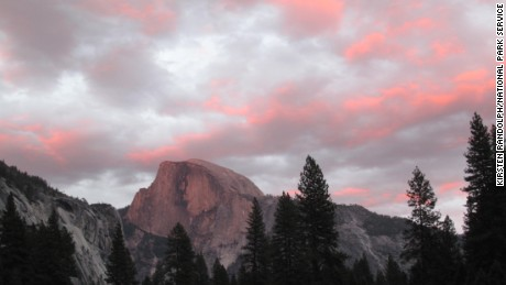 A view of Half Dome from Cook's Meadow at Yosemite National Park shows the colors at sunset.