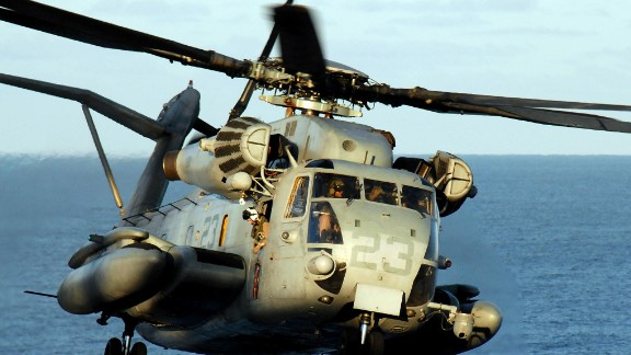 A CH-53E Super Stallion helicopter lands on the flight deck of the amphibious assault ship USS Peleliu