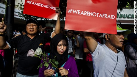 "JAKARTA, INDONESIA - JANUARY 15:  People hold placards and banners displaying the words ""we are not afraid"" during a rally after the Jakarta terrorist attack on January 15, 2016 in Jakarta, Indonesia. Islamic State suicide bombers and gunmen struck the capital of Indonesia on January 14, killing at least two and wounding 24 during the attacks.  (Photo by Oscar Siagian/Getty Images)"