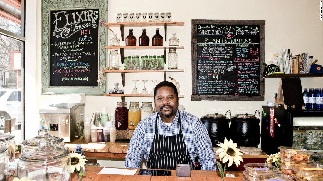 Torrey Spivey and wife Shana own Your Vitamin Lady, a store on Auburn Avenue that sells herbs and homeopathic remedies. The business is popular with residents of low-income housing across the street. They say a new streetcar has brought more tourists to the King historic district but also more panhandlers.