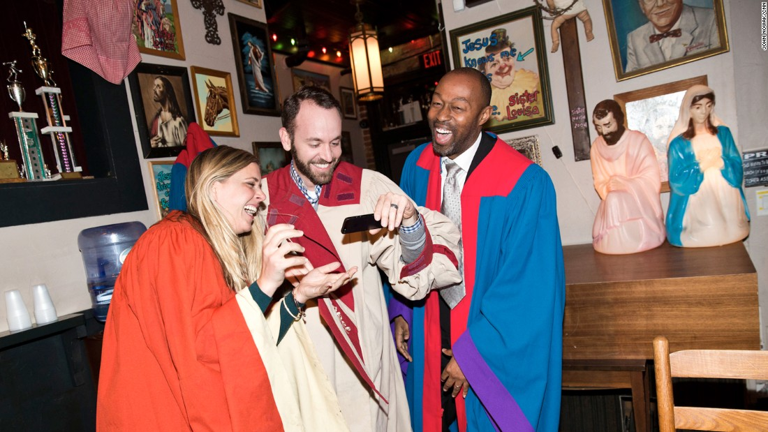 Out-of-towners Melissa Stoller, Alec Gorynski and Rob Toney-Robinson enjoy the campy vibe at Sister Louisa's Church of the Living Room & Ping Pong Emporium on Edgewood Avenue. Simply known as Church to locals, the bar's launch in 2010 kicked off a nightlife renaissance in the area that draws massive crowds on the weekends, much to the chagrin of some locals who worry that the area is gentrifying.