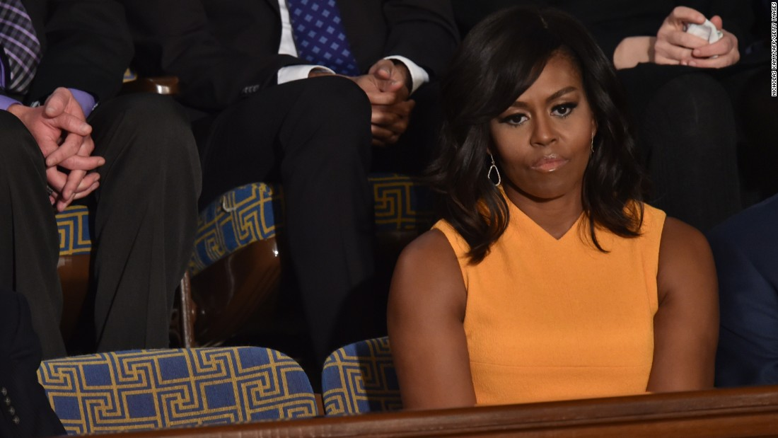 "First lady Michelle Obama sits beside an empty chair as President Barack Obama delivers his <a href=""http://www.cnn.com/2016/01/12/politics/gallery/state-of-the-union-2016/index.html"" target=""_blank"">State of the Union address</a> on Tuesday, January 12. The White House said the chair was left empty to symbolize ""the victims of gun violence who no longer have a voice."""