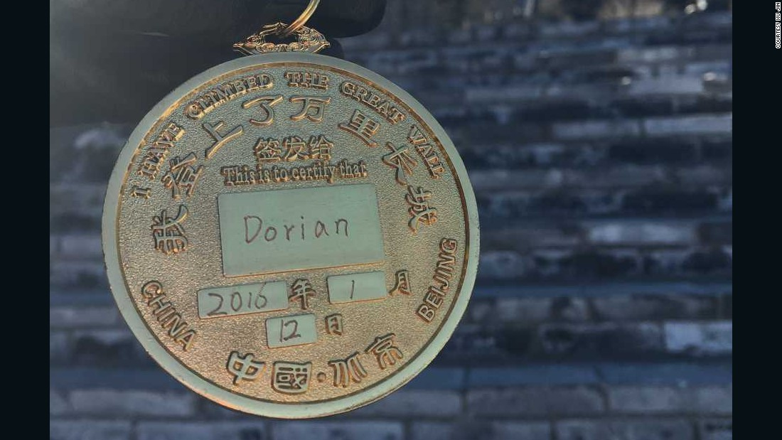 "Xu also managed to get a medal, which says that Dorian ""has climbed the Great Wall""."