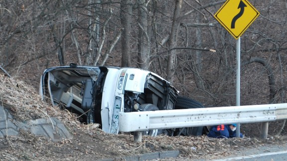 Investigators inspect the wreckage of a bus which crashed on January 15, 2016.