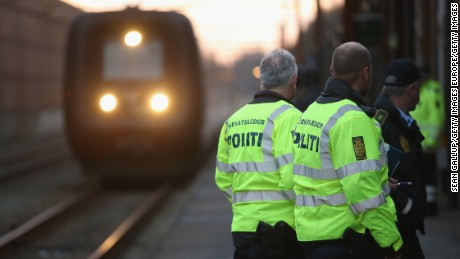 Danish police in Padborg prepare to board a train from Germany to check passengers' identity papers.