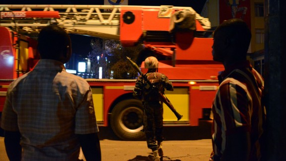 "Burkina Faso's soldier stands near Hotel Splendid where the attackers remain with sporadic gunfire continuing in Burkina Faso's capital Ouagadougou on January 15, 2016. Attackers have killed ""several people"" at a restaurant opposite a four-star hotel where the assailants are holed up, a restaurant staff member told AFP. / AFP / AHMED OUOBA        (Photo credit should read AHMED OUOBA/AFP/Getty Images)"