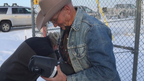 LaVoy Finicum dismantles what he said was a feds' spy camera in mid-January.