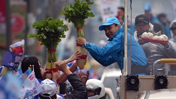 Chu receives a radish, meaning good luck in Taiwanese, from supporters as he campaigns in northern Taiwan on Wednesday, January 13.