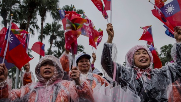 Supporters cheer while Chu parades through the streets during a rally on January 15.