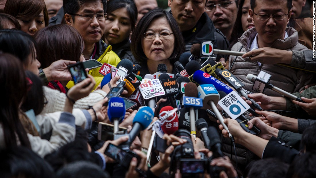 Tsai Ing-wen talks to journalists after casting her ballot at a polling station. She will have her work cut out balancing the interests of China, which is the island's biggest trading partner, the United States, its key ally, and the diverse demands of the island's 23 million residents.<br />