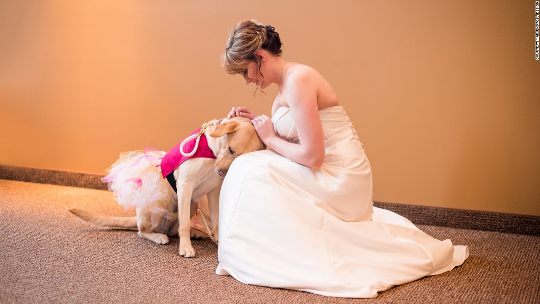 Valerie Parrott and her service dog, Bella, share a touching moment on Saturday, January 9, before the bride walks down the aisle in Sioux Falls, South Dakota.