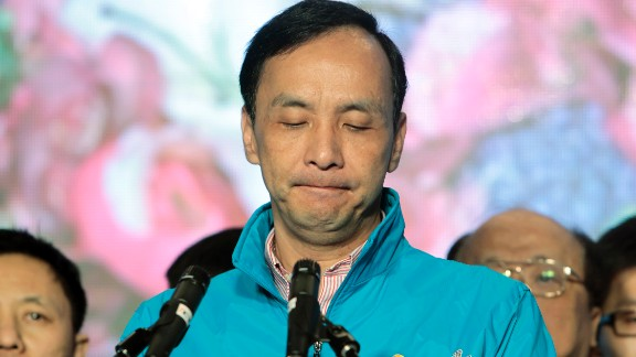Taiwan's ruling Nationalist Party candidate Eric Chu delivers a speech as he concedes in the presidential election.