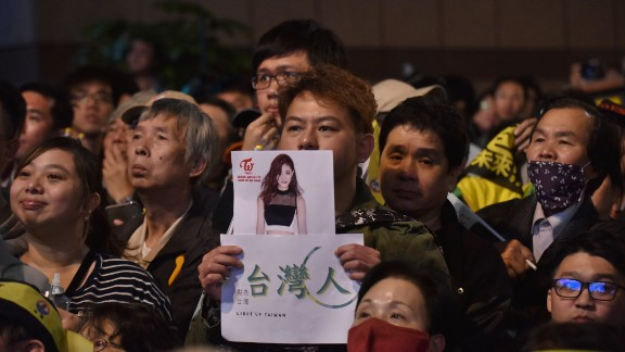 A supporter of Taiwan's Democratic Progressive Party (DPP) holds up a placard of K-pop artist Chou Tzu-yu, a member of the South Korean all-girl band TWICE and who was forced to apologize after waving the Taiwan flag. The apology stirred angry debate.