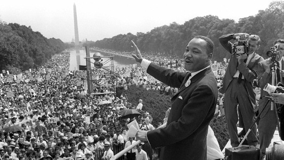 """Martin Luther King Jr. waves to supporters from the steps of the Lincoln Memorial on August 28, 1963, during the march on Washington, when King delivered his famous """"I Have a Dream"""" speech."""
