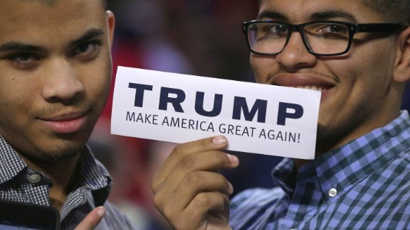 LYNCHBURG, VA - JANUARY 18:  Two young men hold up a bumper sticker which says