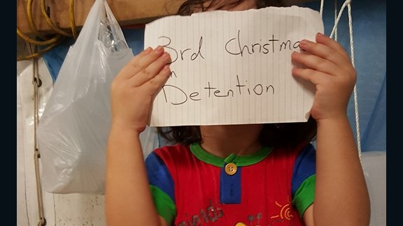 "An image on the Facebook site ""Free the Children NAURU,"" uploaded in November, 2015, shows a small child with a tally of how long they have been on the island."