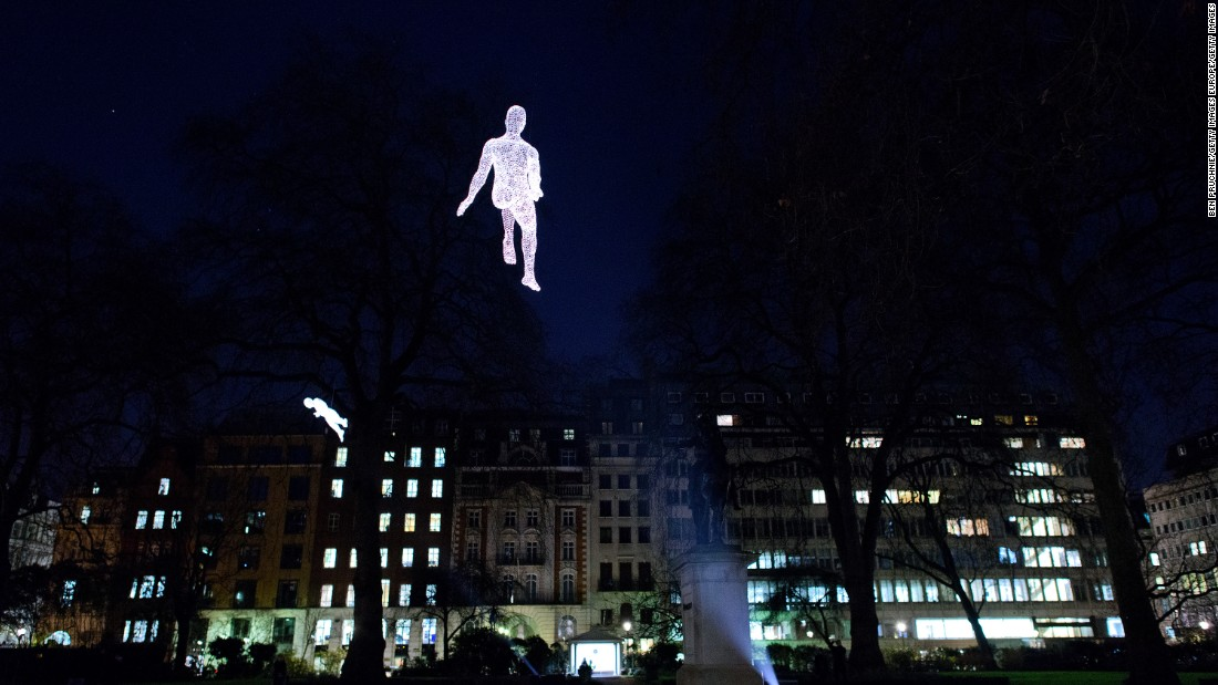 The Les Voyageurs (The Travellers) series by Parisian artist Cedric Le Borgne sees human figures float silently in mid-air or perched on the edges of buildings.