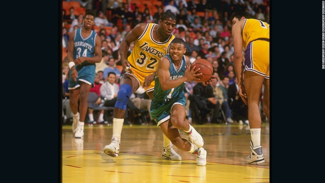 Bogues in action for the Hornets against LA Lakers legend Magic Johnson during the 1990-91 NBA season.