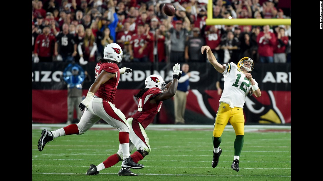 "Green Bay Packers quarterback Aaron Rodgers launches a ""Hail Mary"" touchdown pass on the final play of regulation Saturday, January 16, in Glendale, Arizona. The 41-yard pass to Jeff Janis forced overtime, but the Arizona Cardinals won 26-20 to advance to the NFC Championship game."