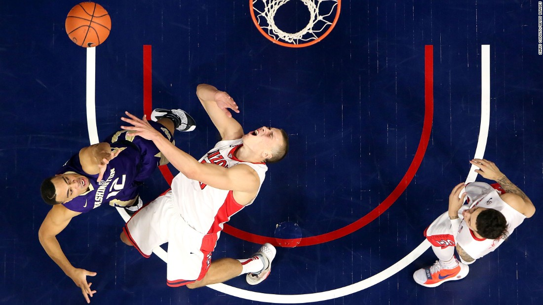 Arizona center Kaleb Tarczewski falls backward after Washington's Andrew Andrews ran into him during a college basketball game in Tucson, Arizona, on Thursday, January 14.