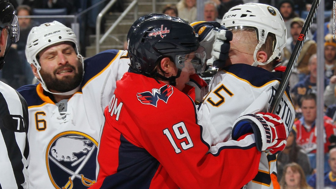 Washington's Nicklas Backstrom, center, tussles with Buffalo's Rasmus Ristolainen during an NHL hockey game in Buffalo, New York, on Saturday, January 16.