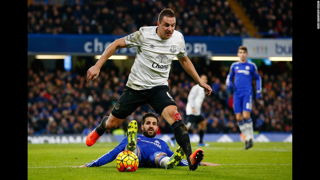 Everton defender Phil Jagielka, foreground, is tackled by Chelsea's Cesc Fabregas during a Premier League match in London on Saturday, January 16.