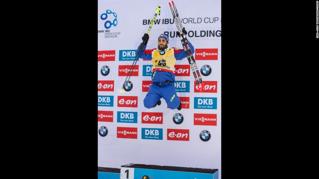 French biathlete Martin Fourcade jumps on the medal stand after winning a World Cup race in Ruhpolding, Germany, on Wednesday, January 13.