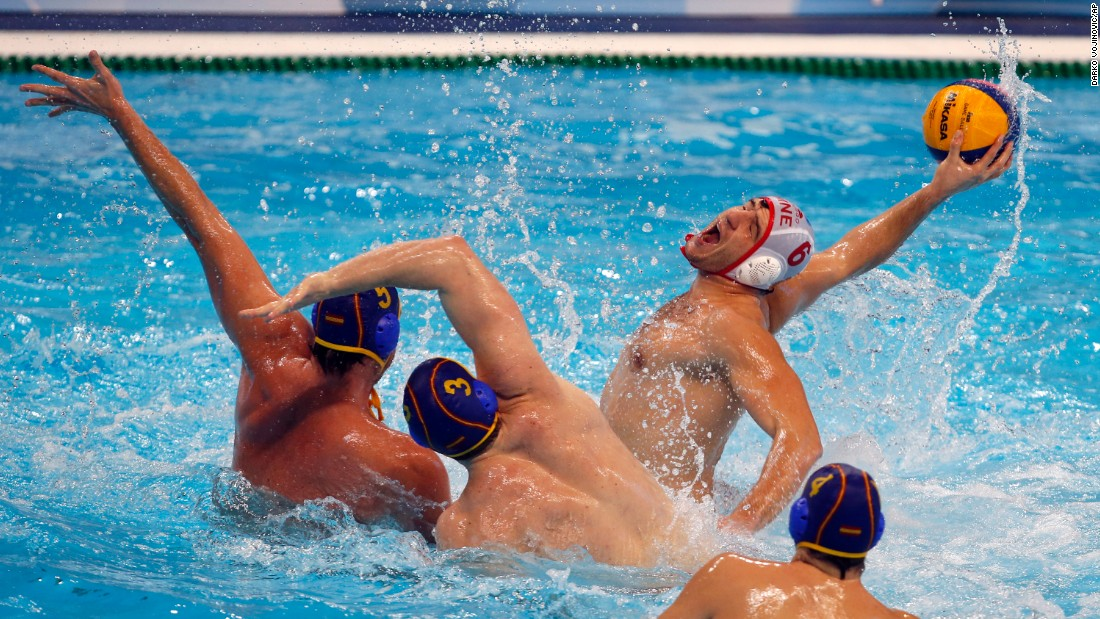 Montenegro's Aleksandar Radovic prepares to shoot against Spain during a water polo match in Belgrade, Serbia, on Tuesday, January 12.