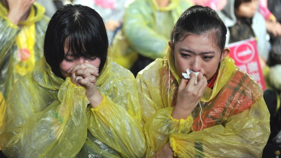 Emotional supporters react after Tsai lost her 2012 bid for the presidency.