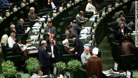"Iranian members of parliament attend a parliamentary session in Tehran on June 23, 2015. Iranian lawmakers passed a bill obliging the government to safeguard the country's ""nuclear rights and achievements,"" despite talks with global powers on curbing the Islamic republic's disputed atomic programme. AFP PHOTO / BEHROUZ MEHRI        (Photo credit should read BEHROUZ MEHRI/AFP/Getty Images)"