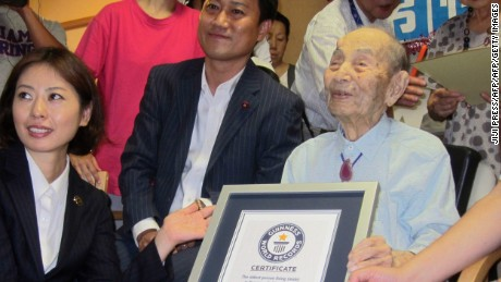 Yasutaro Koide, 112, receives a Guinness World Records certificate as the oldest living man in August.