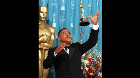 "Cuba Gooding Jr. throws his Oscar into the air after being named best supporting actor for his role in ""Jerry Maguire"" in 1997."