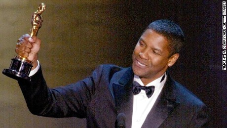 HOLLYWOOD, :  Denzel Washington accepts his Oscar for Best performance by an actor in a leading role  during the 74th Academy Awards at the Kodak Theater in Hollywood 24 March 2002.  AFP PHOTO  TIMOTHY A. CLARY (Photo credit should read TIMOTHY A. CLARY/AFP/Getty Images)