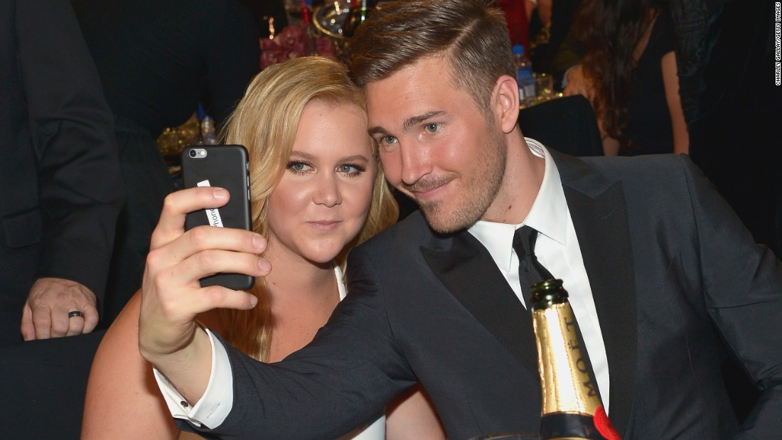 Actress and comedian Amy Schumer poses with her new boyfriend, Ben Hanisch, at the Critics' Choice Awards on Sunday, January 17. Schumer won the MVP Award at the event.