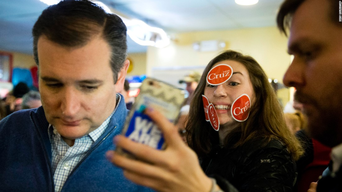 A young woman tries to get a selfie with U.S. Sen. Ted Cruz during the presidential candidate's campaign stop in Tilton, New Hampshire, on Monday, January 18.