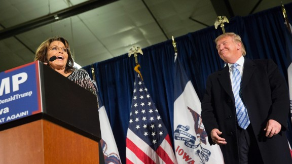 Republican presidential candidate Donald Trump looks on as former Alaska Gov. Sarah Palin speaks at Hansen Agriculture Student Learning Center at Iowa State University on January 19, 2016 in Ames, IA.