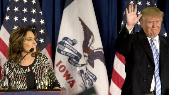 AMES, IA - JANUARY 19:   Republican presidential candidate Donald Trump acknowledges the crowd as former Alaska Gov. Sarah Palin speaks at Hansen Agriculture Student Learning Center at Iowa State University on January 19, 2016 in Ames, IA. Trump received Palin