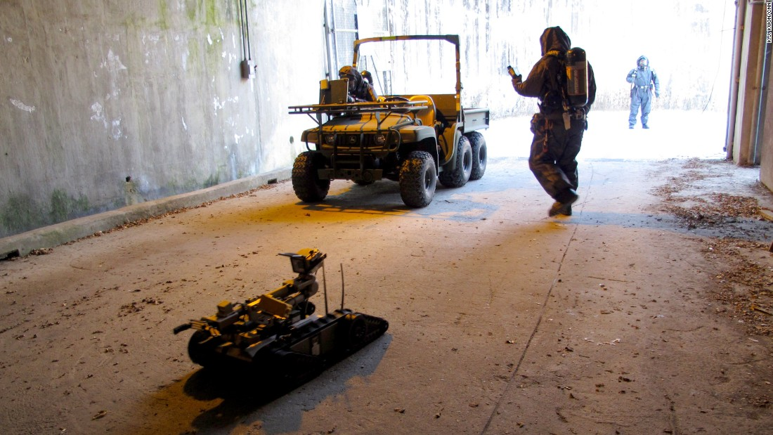 A remote-controlled robot is deployed to the suspected site to monitor radiation levels and chemical agents.