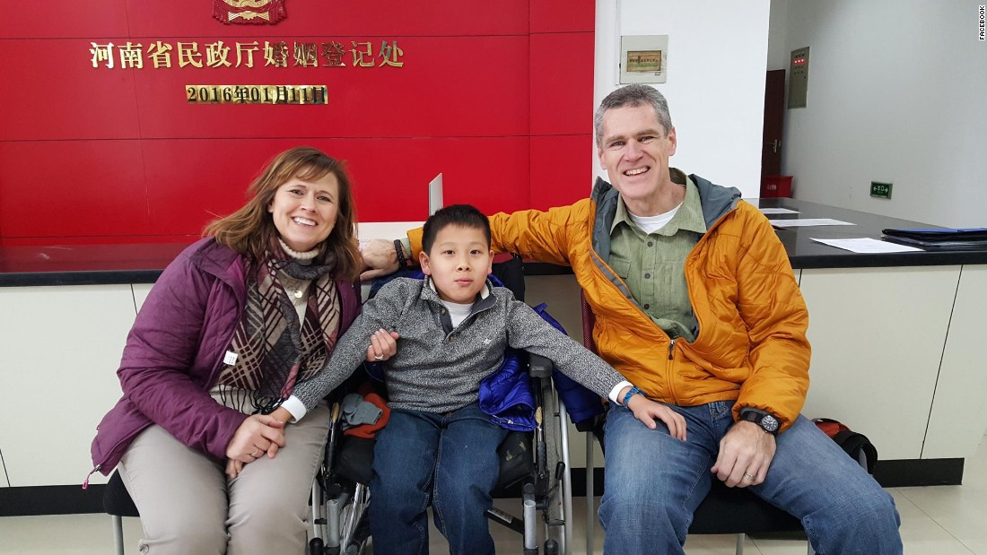 The Wilsons and JiaJia at the local Marriage Registration Office of Henan Provincial Civil Affairs Bureau. The couple waded through mountains of paperwork to adopt him into their family.