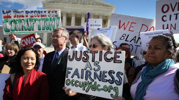 Protesters rally in front of the US Supreme Court to urge the overturning of the court