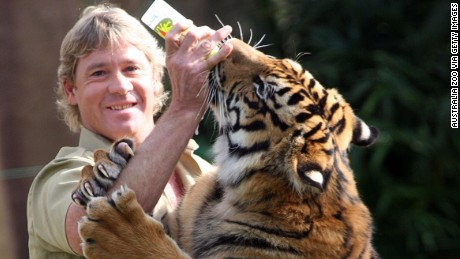The late Steve Irwin poses with a tiger at Australia Zoo June 1, 2005.