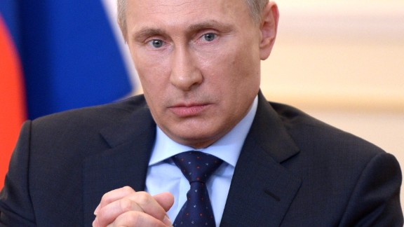 Russian President Vladimir Putin looks on during a press conference in his country residence of Novo-Ogaryova outside Moscow on March 4, 2014.
