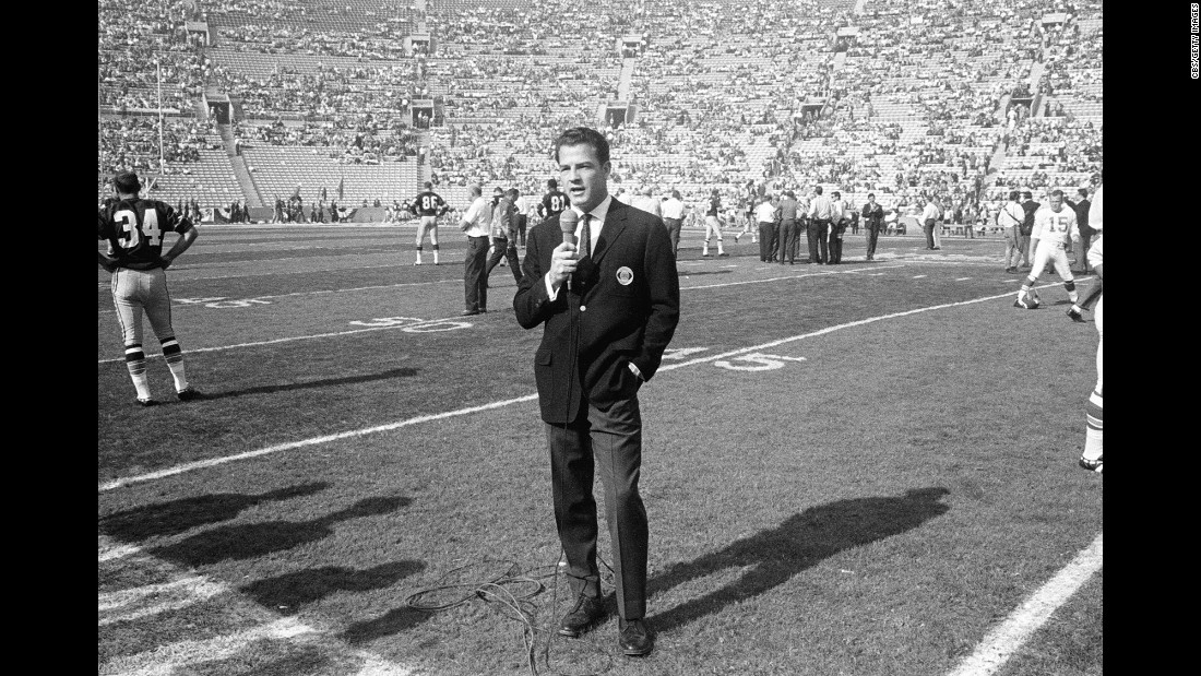 CBS commentator Frank Gifford works on the field before the game. The game was televised by both CBS and NBC. CBS held the rights to NFL games, while NBC had the rights to AFL games.