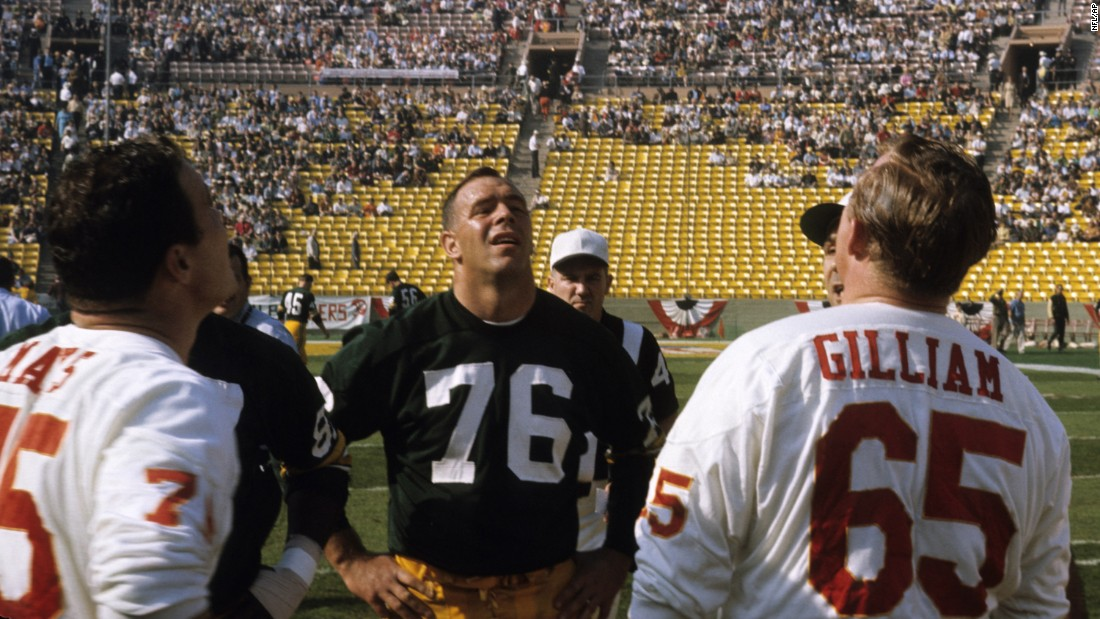 Chiefs center Jon Gilliam -- across from Packers tackle Bob Skoronski -- watches the pregame coin toss.