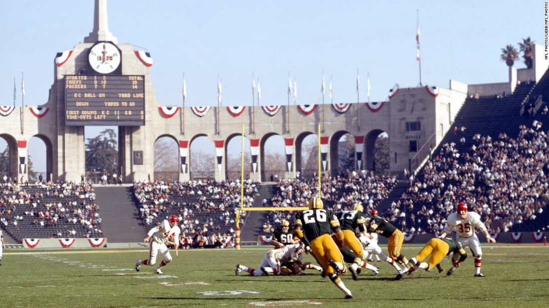 Herb Adderley (No. 26) returns a kickoff during the game. Adderley, a Hall of Fame cornerback, played nine seasons with the Packers.