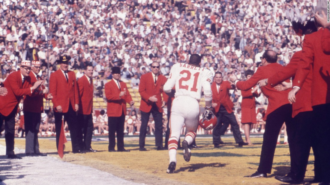 Chiefs running back Mike Garrett runs onto the field during pregame introductions.