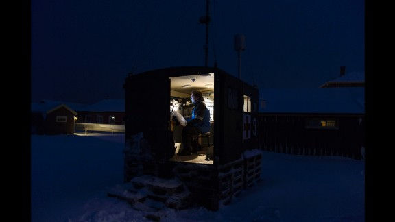 Senior scientist Ove Hermansen works in a small research cabin.