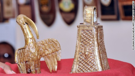 "A picture shows two artifacts from the ""Benin Bronzes"" collection, a long-beaked bird and the monarch's bell, returned to the Benin kingdom by a British pensioner during a ceremony in Benin City, Nigeria, on June 20, 2014."