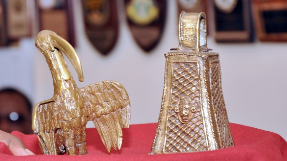 "A picture shows two artifacts from the ""Benin Bronzes"" collection, a long-beaked bird and the monarch"